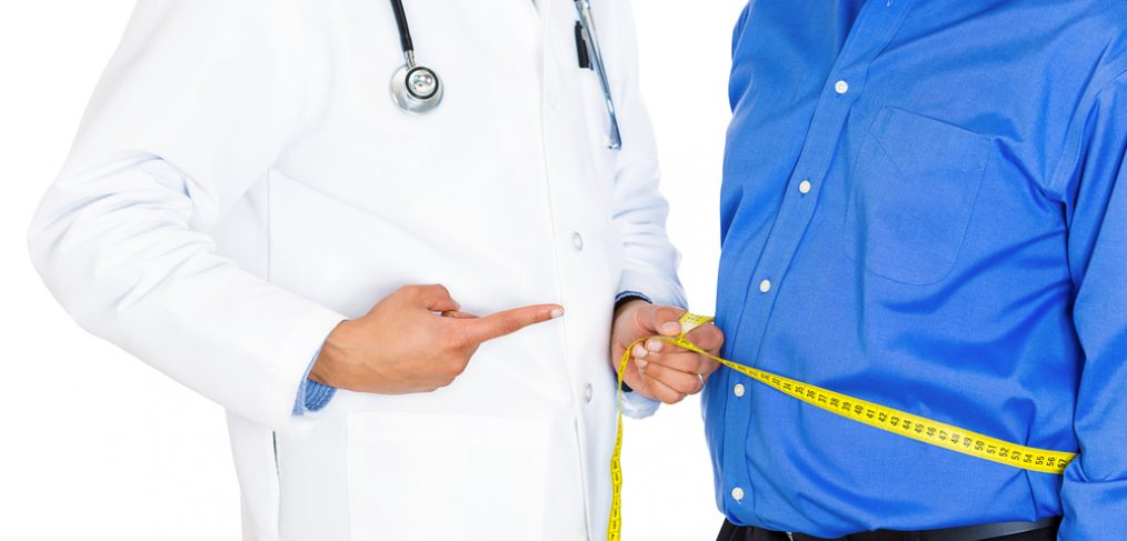 Doctor measure the waist of a make patient