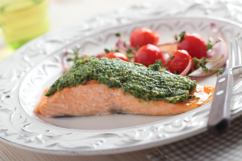 Baked salmon with pesto and vegetables