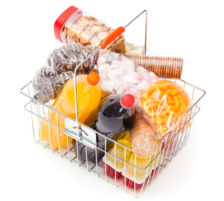 Shopping basket with assortment of unhealthy food on white background