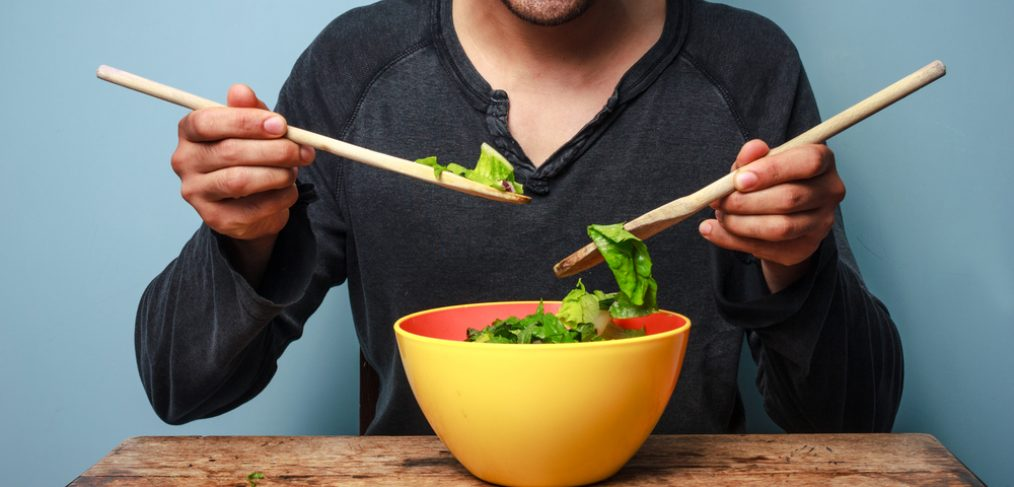 Man eating a healthy salad
