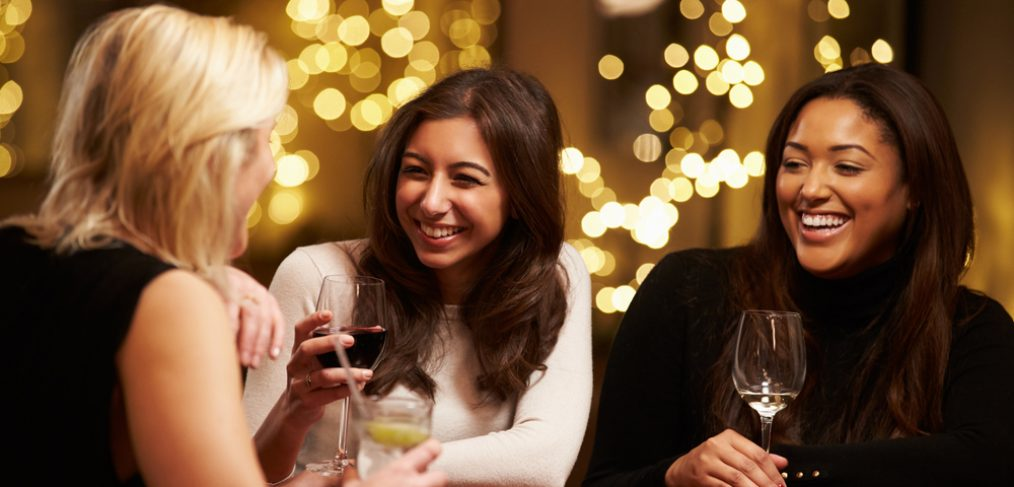Group of women having fun and drinking wine