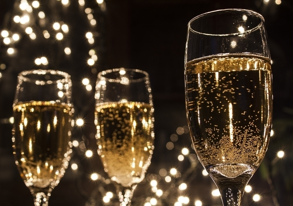 Glasses of champagne in a black background.