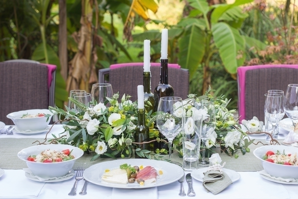 Beautiful flower arrangement set up for an outdoor party.