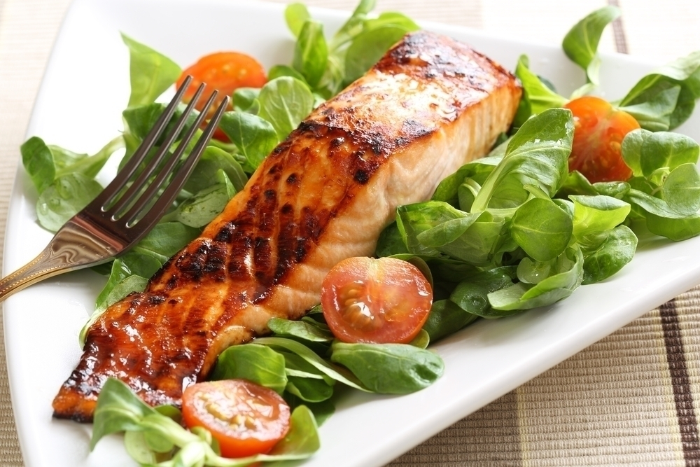 Salmon dish with side salad