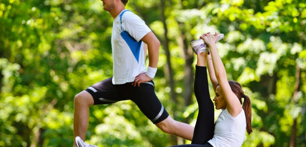 Couple exercising in a park.