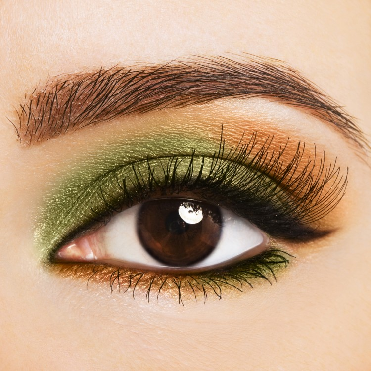 Woman with olive green eye makeup.