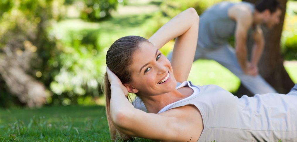 Couple exercising in the park,.