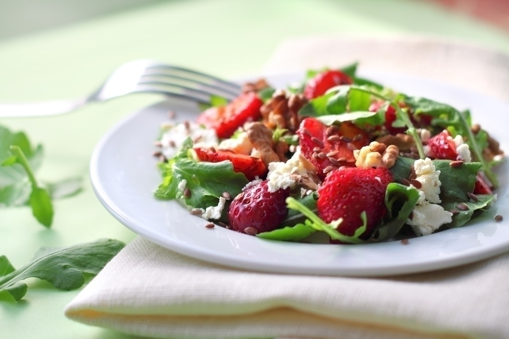 Strawberry salad on a plate.