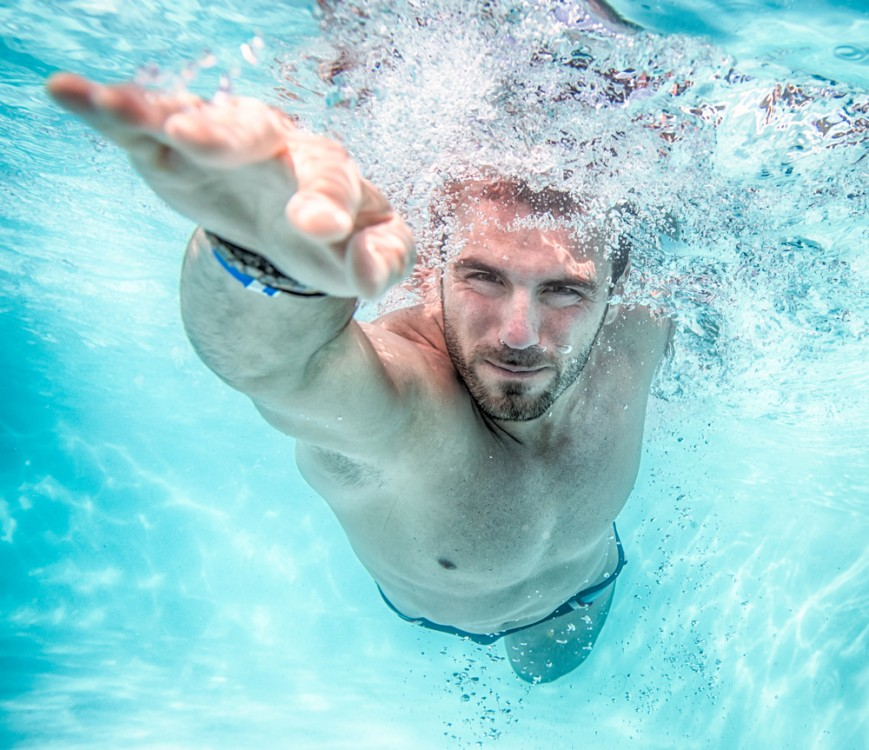 Man swimming in a swimming pool