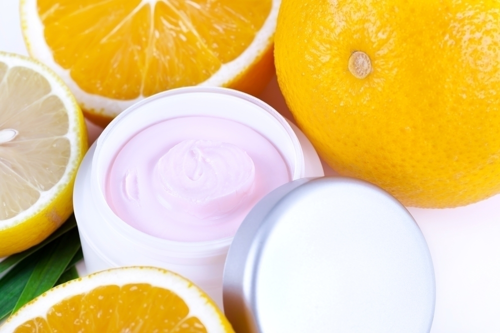 Anti-aging cream between oranges.