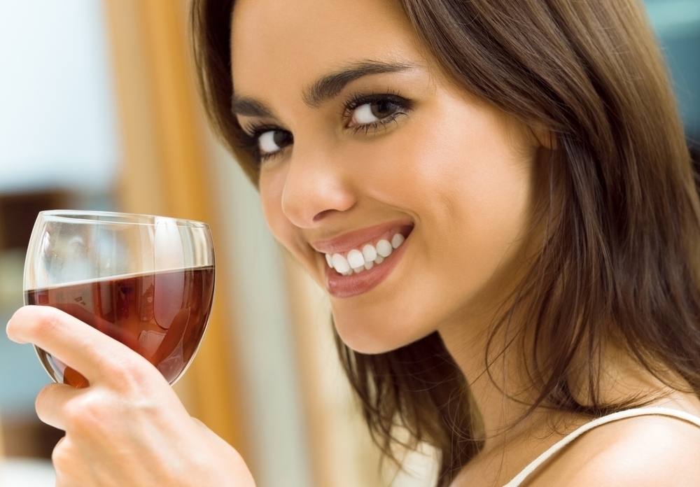 Woman having red wine