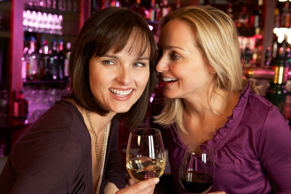 Women having red wine in a bar.
