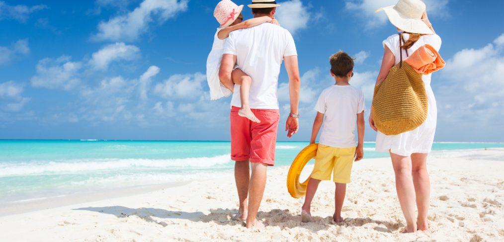 Family walking on a beach.