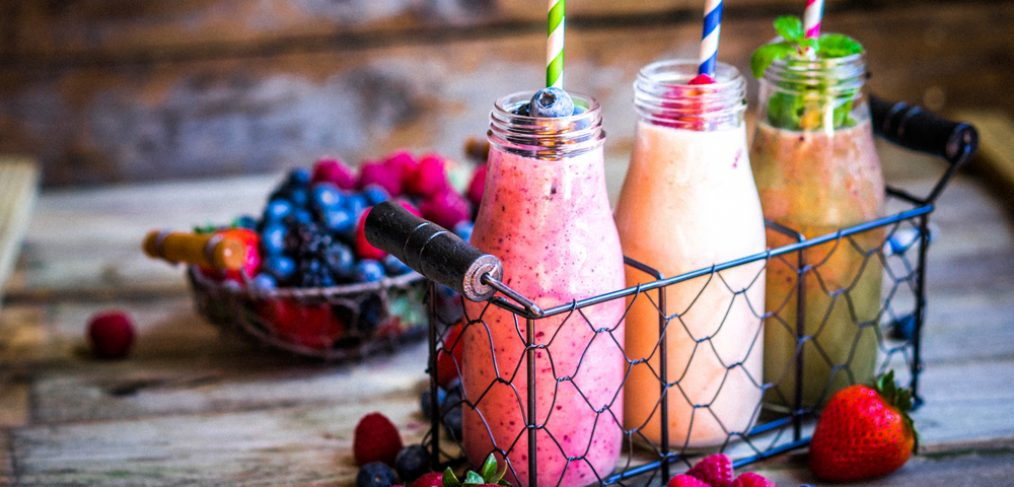 Smoothies on a wooden table.