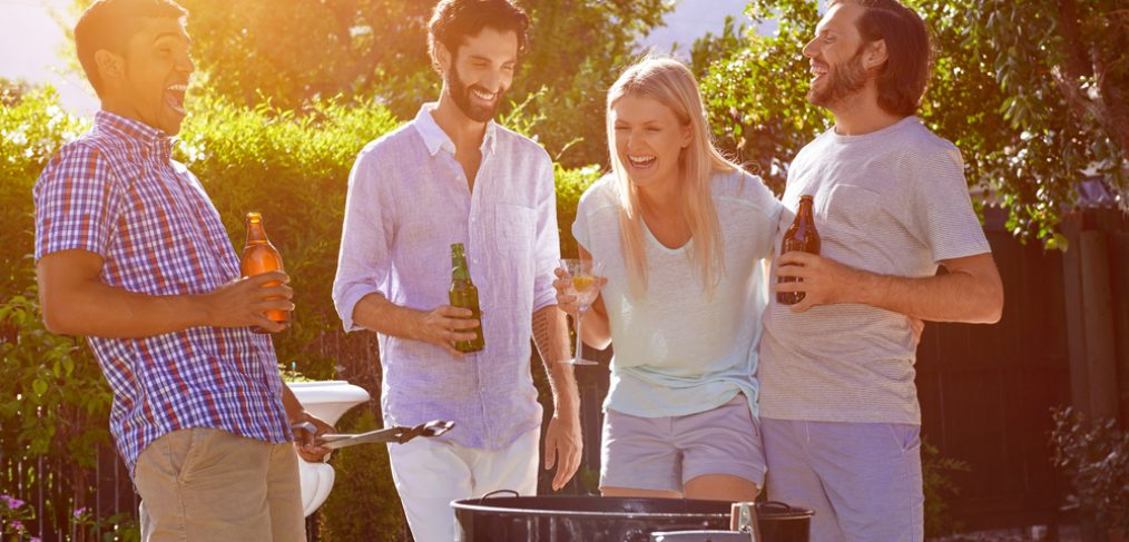 Friends having fun in a summer BBQ