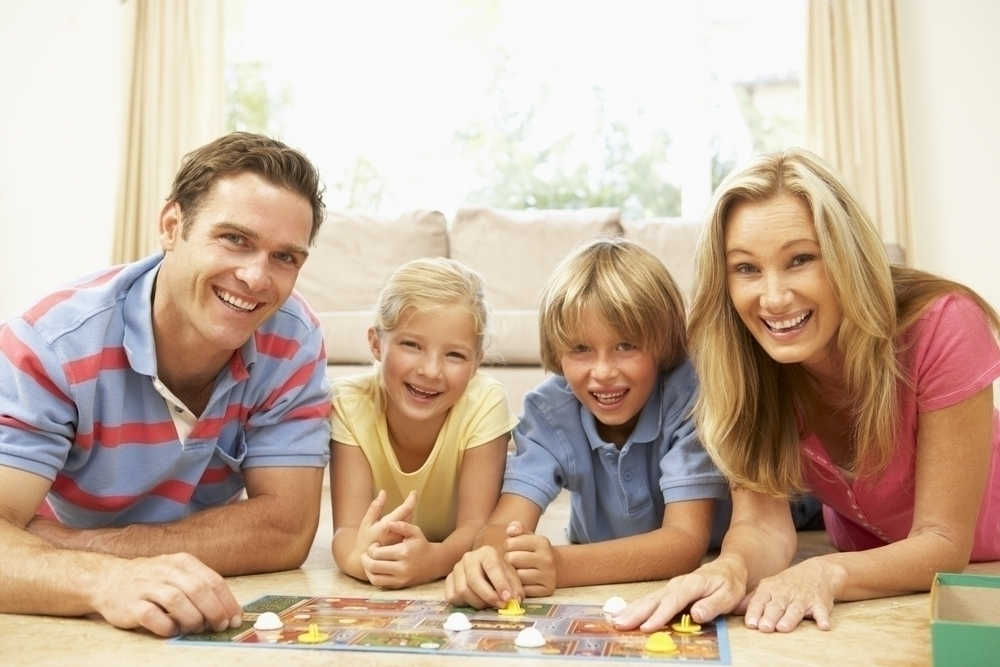 Family playing a board game.