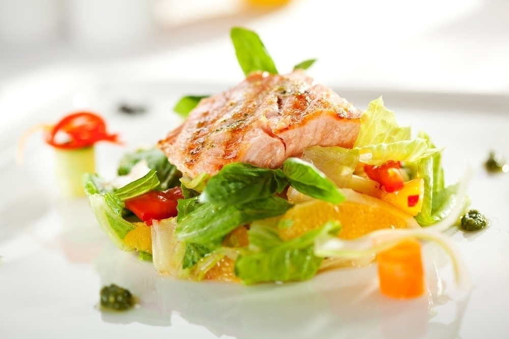 Salmon with green leafy vegetables.