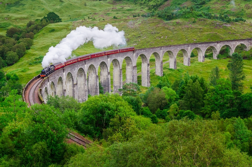 Steam train on the famous Glenfinnan viaduct, Scotland.