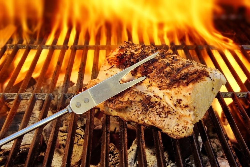 Pork brisket on a grill.