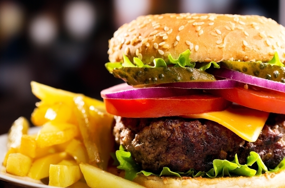 Juicy hamburger and fries.