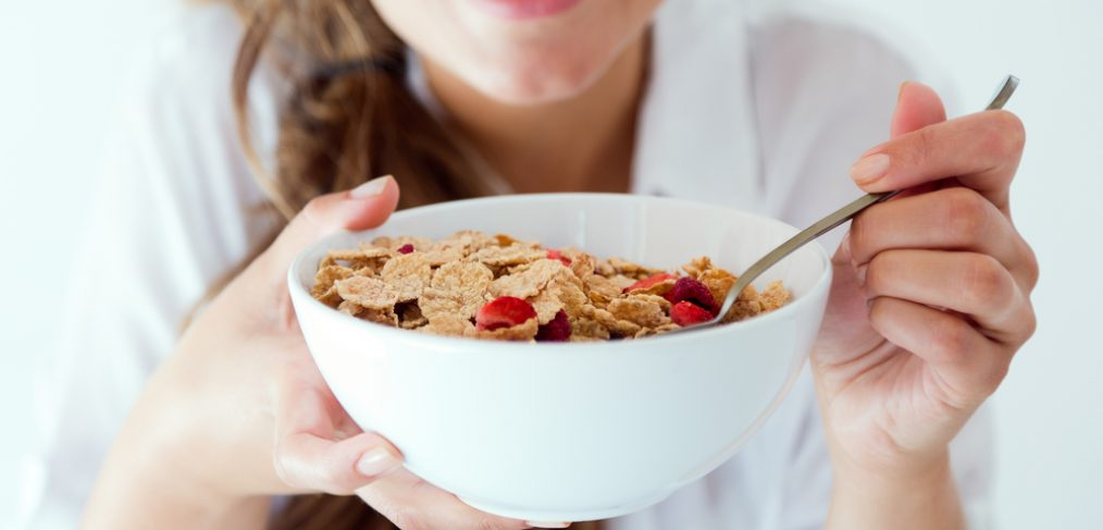 Woman eating cereals.