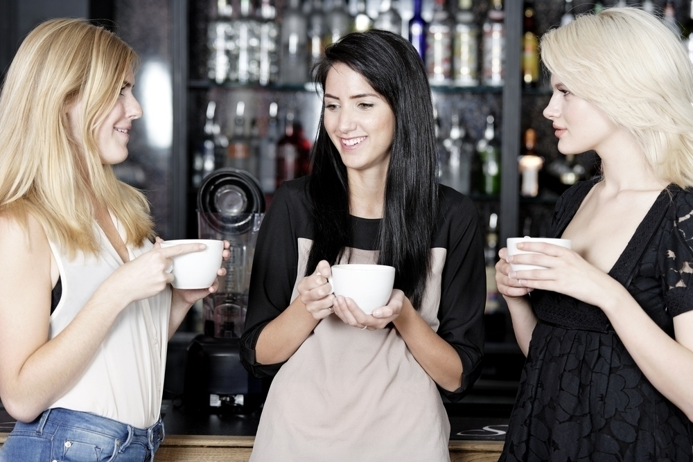 Women having coffee in a bar.