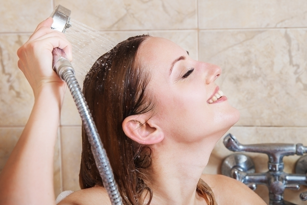 Woman taking a shower.
