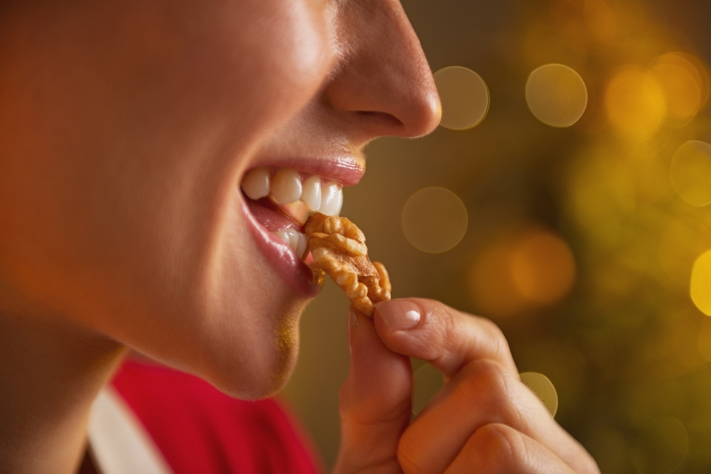 Woman eating walnut