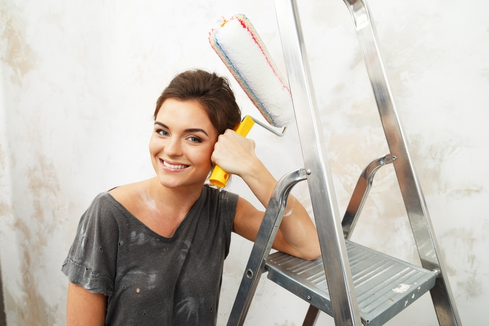 Woman painting walls