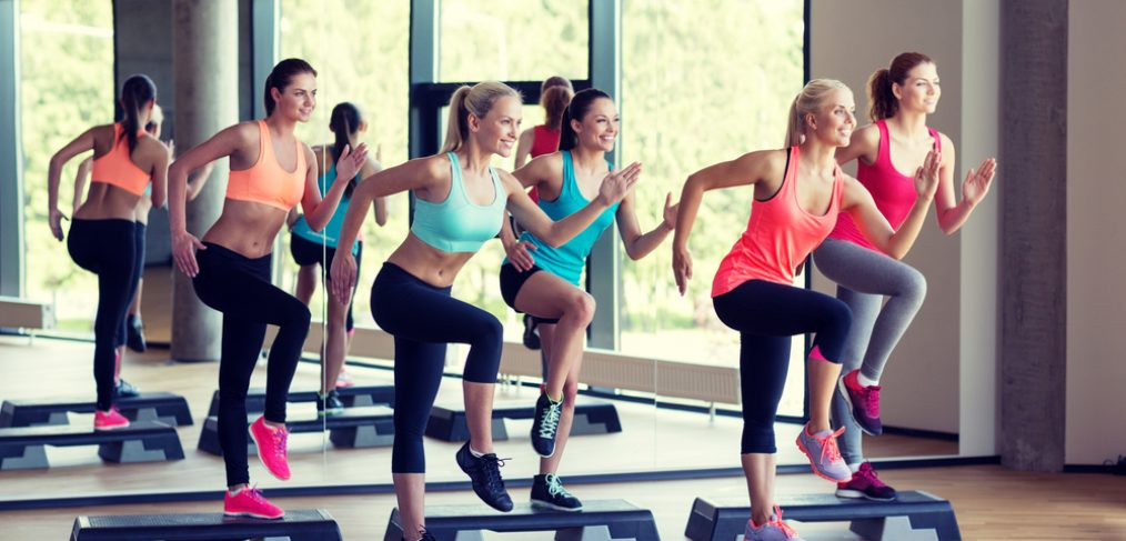 Group of people exercising in aerobics class