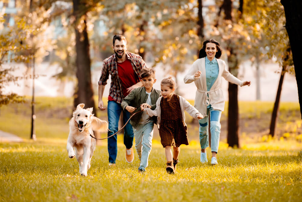 Family running with the dog