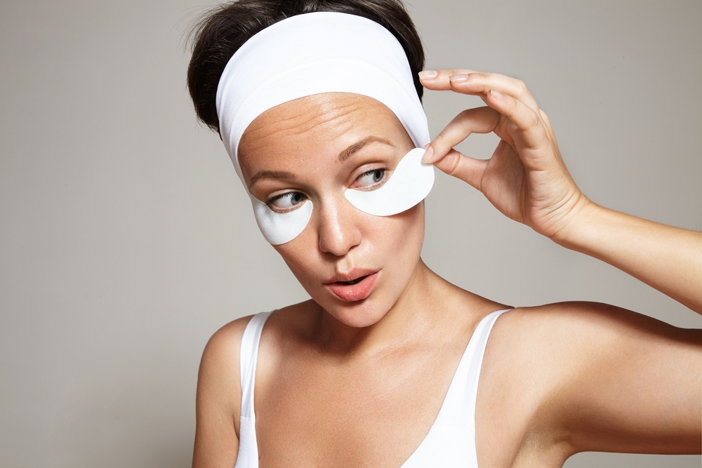 Woman taking off her eye mask