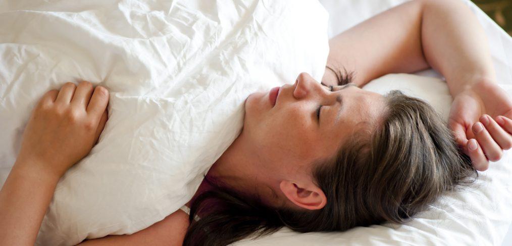 Woman sleeping on her back