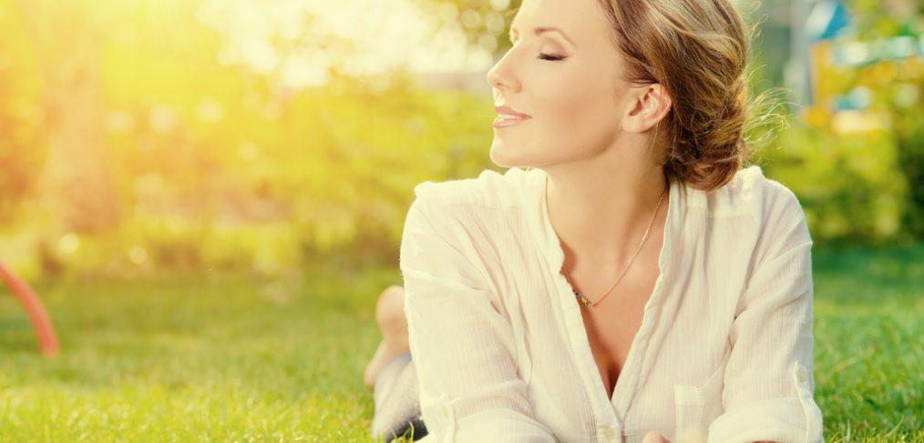 Woman enjoying the sun in the grass