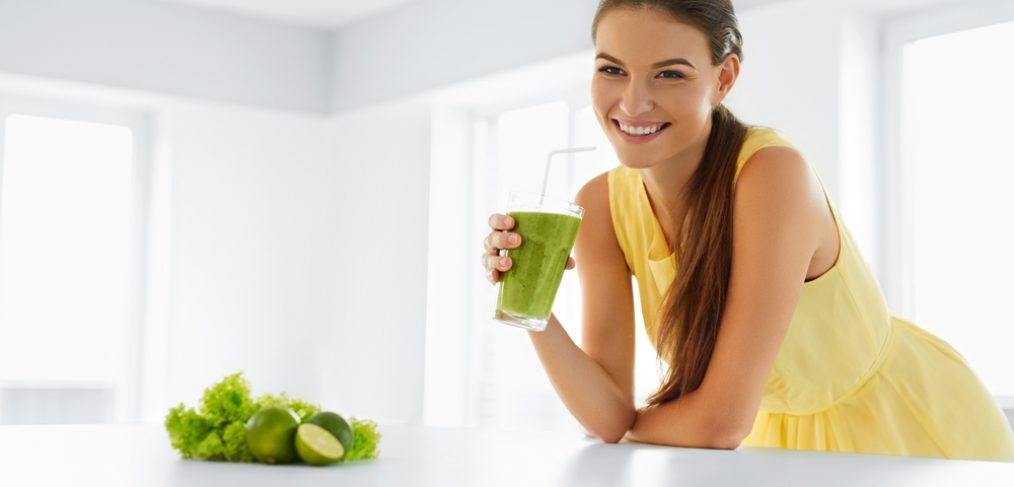 Woman drinking a detox smoothie
