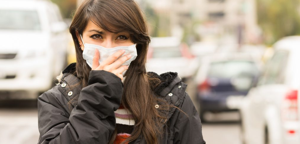 Women walking in polluted air with a mask