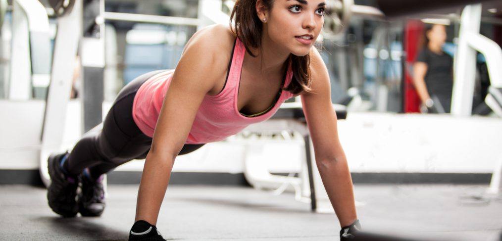 Woman doing push-ups at the gym