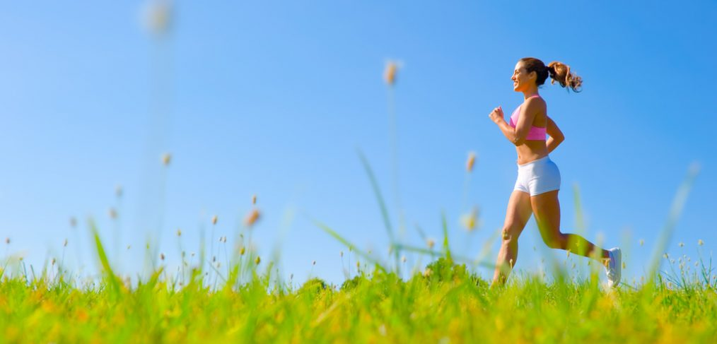 Healthy woman jogging outdoors
