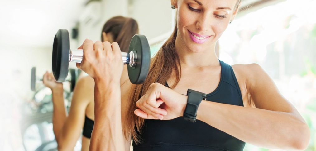 Woman working out while looking at wrist watch