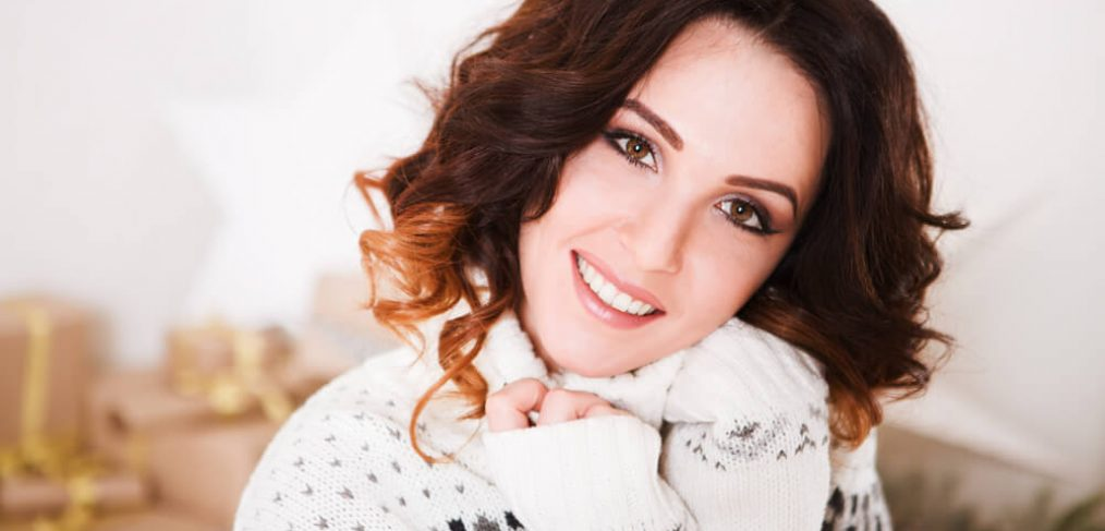 Smiling woman in winter sweater