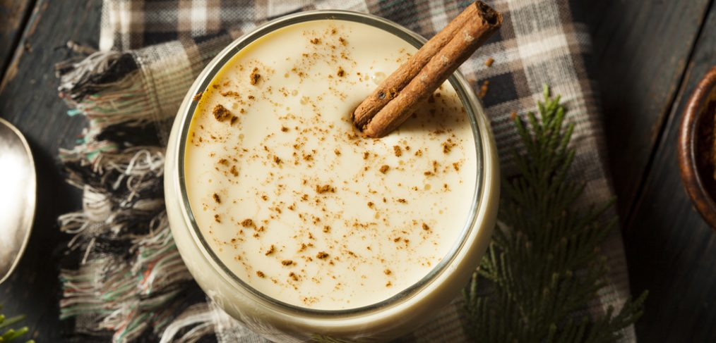 Eggnog with cinnamon stick