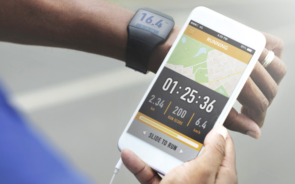 Checking watch and mobile phone app for workout statistics