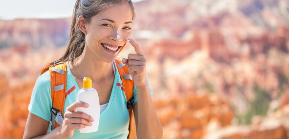Lady applying sunscreen