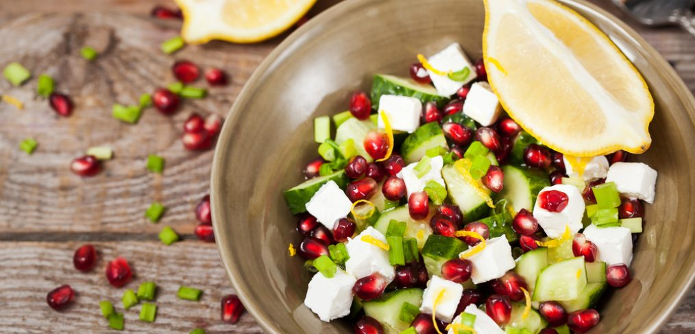 Pomegranate salad on wooden table