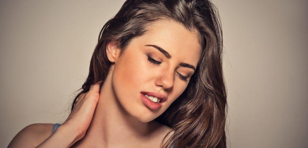 woman massaging painful neck