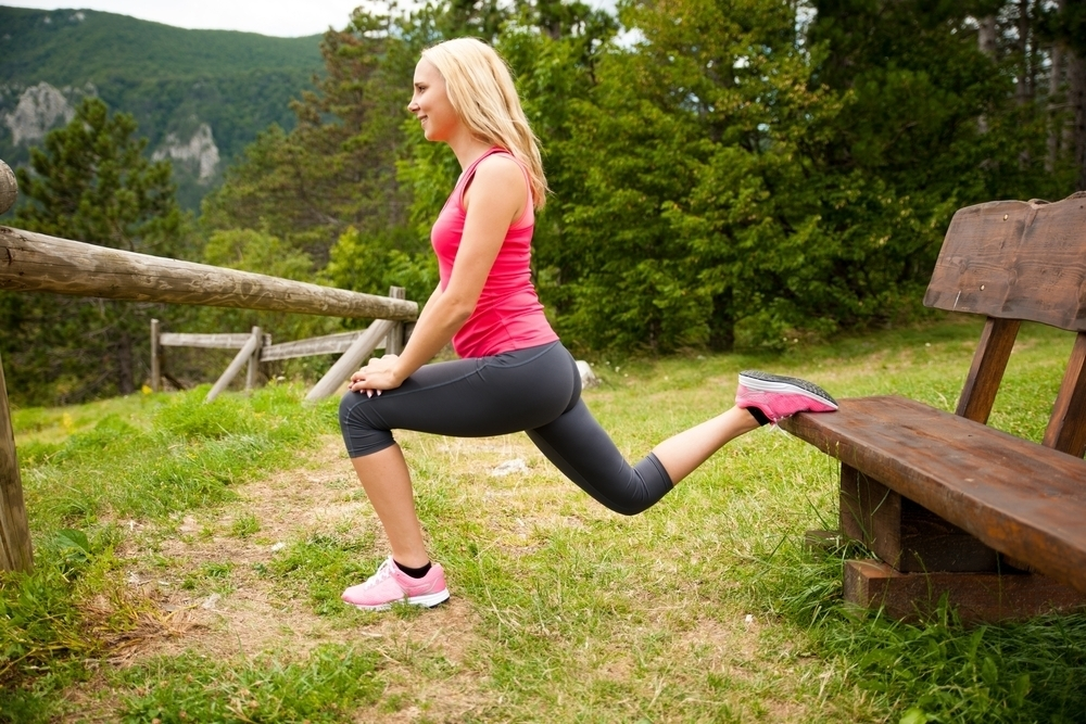Woman doing lunges outdoors