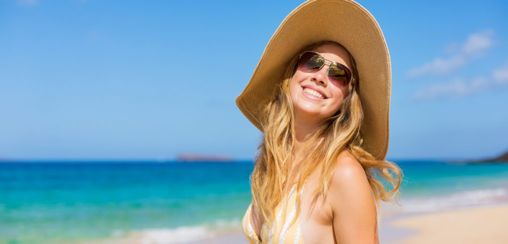 Girl in hat at the beach