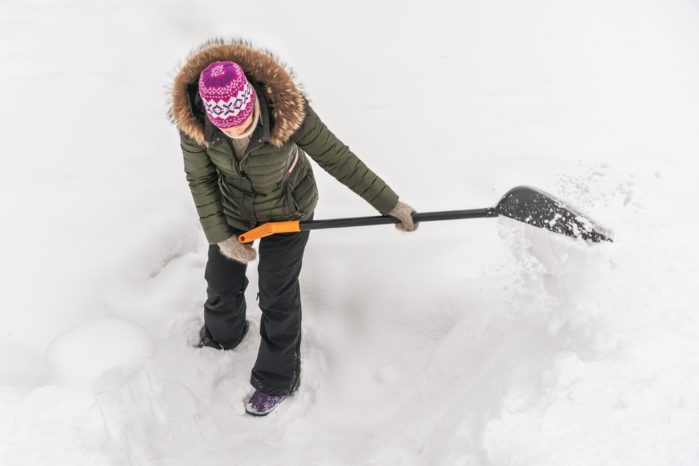 Woman shovelling snow