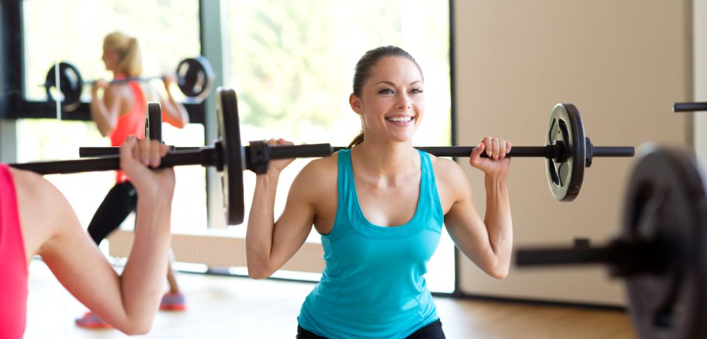 Woman using barbells