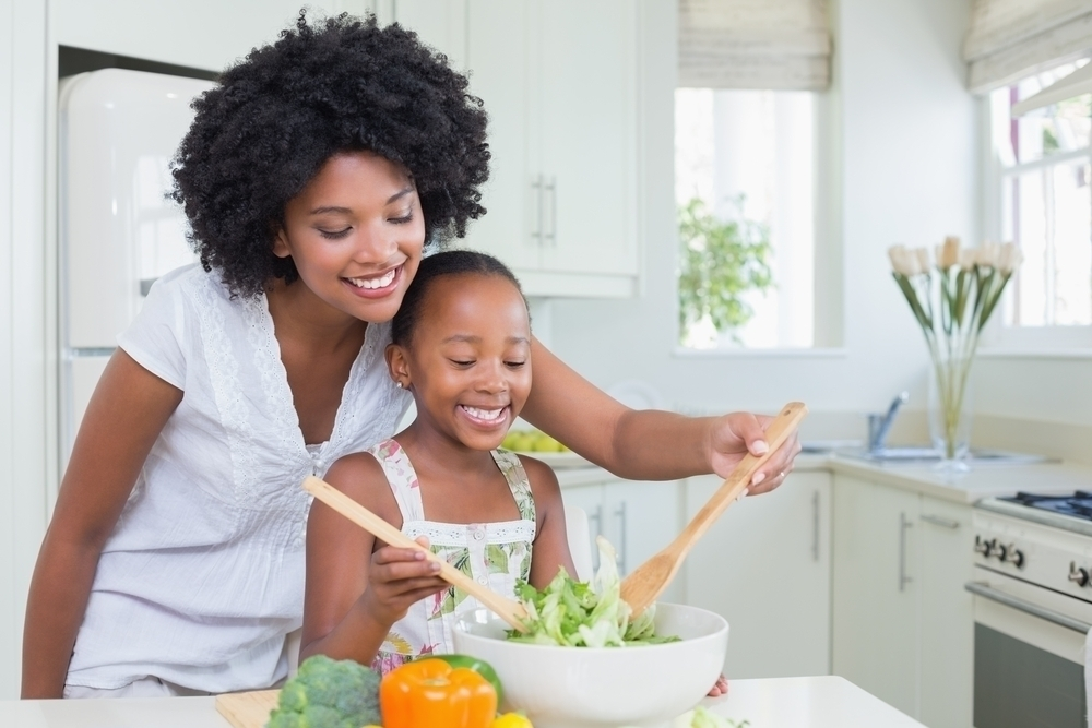 Woman and child making salad